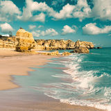 Golden beaches of Albufeira. Golden beaches and sandstone cliffs near Albufeira, Portugal. Tinted image Royalty Free Stock Photos