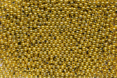 Golden bead background Royalty Free Stock Photo
