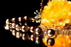 Golden beads Stock Photos