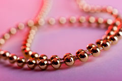 Golden beads Stock Photography