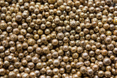 Golden beads background. Shiny golden festive beads texture Royalty Free Stock Images