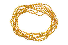 Golden beads border isolated. Christmas frame. Golden shine. Yellow background. Royalty Free Stock Photo
