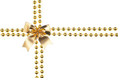 Golden beads with bow Stock Image