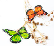 Golden beads with butterfly Stock Images