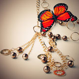 Golden beads with butterfly
