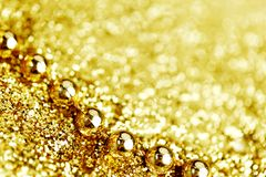Golden beads Royalty Free Stock Image