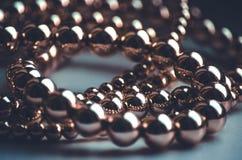 Golden beads low key dark background. Golden beads low key luxury dark background Stock Images