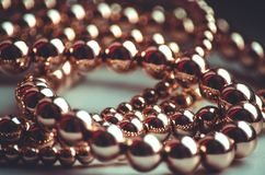 Golden beads valuable necklace. Lays on light surface Stock Image