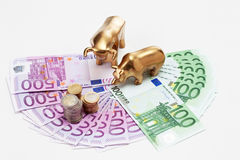 Golden bear and bull figurines with euro coins on fanned euro no Stock Photo