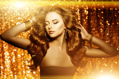 Golden beautiful fashion woman, model with shiny  healthy long v Royalty Free Stock Photos