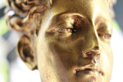 Golden beauty. Statue of a beautiful golden woman, looking almost alive Royalty Free Stock Photos