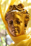 Golden beauty. Statue of a beautiful golden woman, looking almost alive Stock Photo