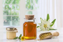 Golden bee pollen in small glass jars with royal jelly and  in a the wooden spoon. Stock Photos