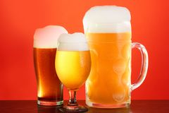 Golden beer in glass with foam, alcohol beverage,  full stock photos