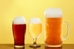 Golden beer in glass with foam, alcohol beverage,  lager cold royalty free stock images