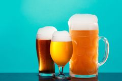 Golden beer in glass with foam, alcohol beverage,  lager drop royalty free stock images