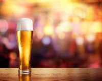 Golden Beer In Glass With Lights Of Bar Royalty Free Stock Images