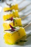 Golden beet lollypops Stock Photos