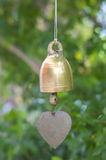 Golden bell with green bokah background Royalty Free Stock Images