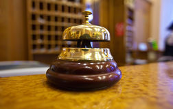 Golden bell  in hotel. Golden bell on  reception desk in hotel Royalty Free Stock Images