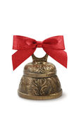 Golden bell and red bow royalty free stock photography