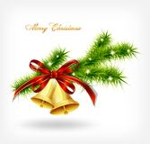 Golden bell with red bow hanging on a green spruce Stock Photo