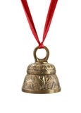 Golden bell and red ribbon Royalty Free Stock Photography