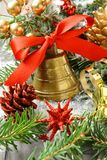 Golden bell with red ribbon bow and christmas decoration Stock Photos