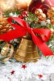 Golden bell with red ribbon bow and christmas decoration Royalty Free Stock Photo