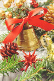 Golden bell with red ribbon bow and christmas decoration Stock Photo