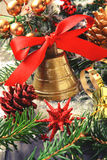 Golden bell with red ribbon bow and christmas decoration Royalty Free Stock Photos