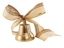 Golden bell with a ribbon bow Royalty Free Stock Images