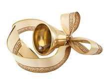 Golden bell with a ribbon bow Stock Photos