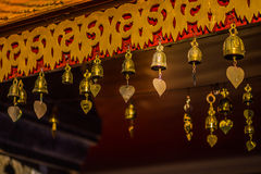 Golden Bell at roof of pavillion around golden pagoda in Wat Phr Stock Images