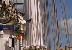 A golden bell on a ship. At a mast and many ropes. Concordia ship - served as a sail training ship; capsized and sank on 17 February 2010 Stock Image
