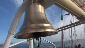 Golden bell of sailing tall ship shining after cleaning stock video