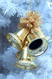 Golden bells. Bell, a symbol or a decoration on Christmas Day stock photos