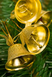 Golden bells on christmas tree Royalty Free Stock Images