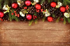Golden bells on fir branches, balls, pines, red berries background stock images