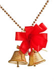 Golden bells with red bow on a beads chain Royalty Free Stock Image