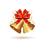 Golden bells and red bow Royalty Free Stock Photos