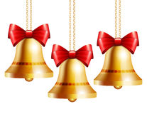 Golden bells with a red bow Royalty Free Stock Photos