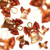 Golden bells with a red bow. isolated on white. Royalty Free Stock Images