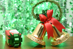 Golden bells with a red bow and red gift box Stock Photography