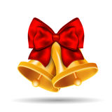 Golden bells with red bow on white background Stock Photo
