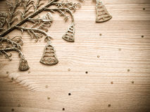 Golden bells and stars on wooden texture background Royalty Free Stock Photo