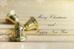 Golden bells with text effect Stock Photos