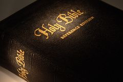 Golden bible. Holy bible close-up reference edition hightllighting gold Royalty Free Stock Image