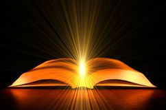 Golden bible. Open bible with the light of god Stock Images