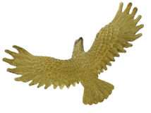 Golden bird in flight Royalty Free Stock Image